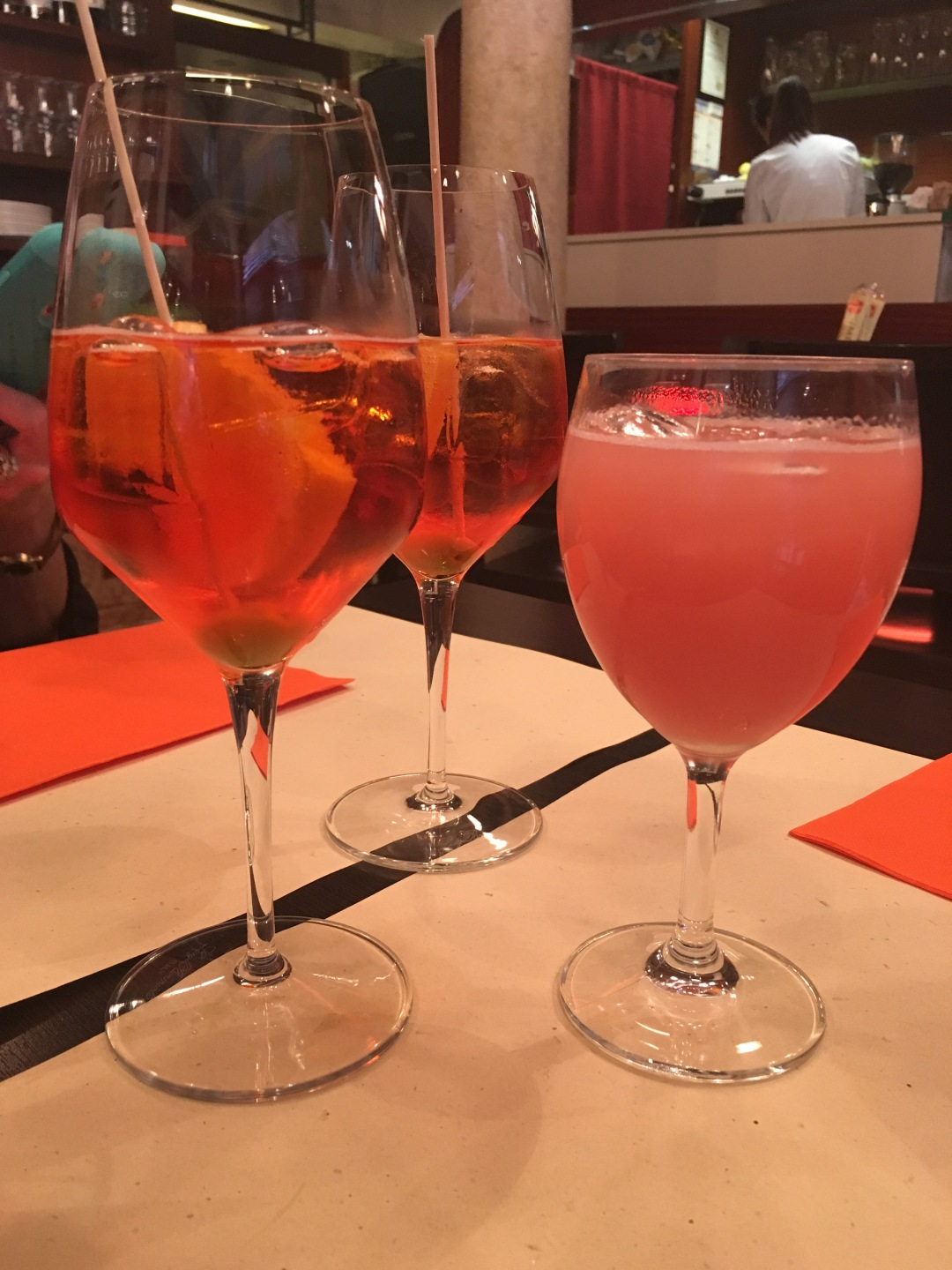 Aperol spritzes and bellinis during aperitivo - an Italy must do