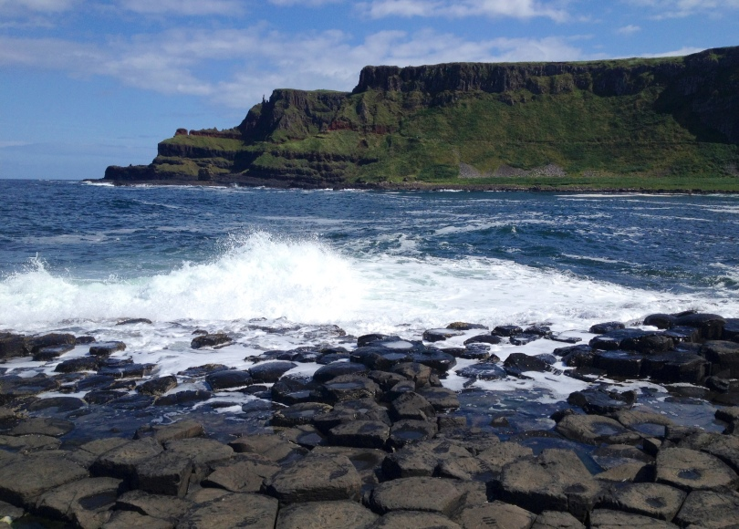 Waves lap against the Giant's Causeway in Northern Ireland