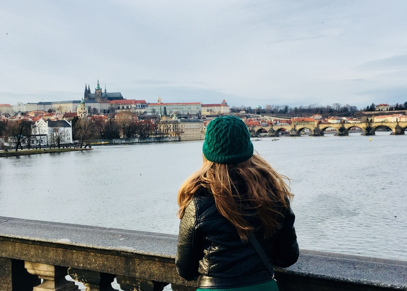 Travelling Prague solo, solo traveller looks out over Prague, Czech Republic
