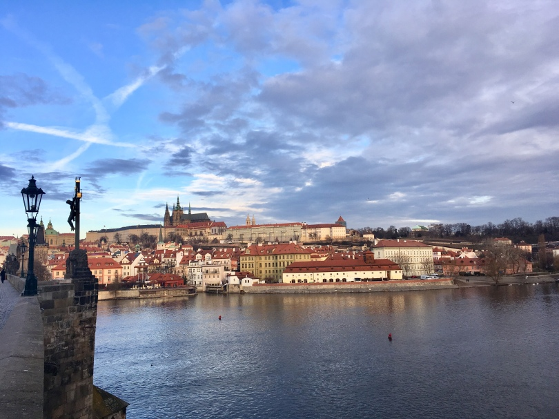View from Charles Bridge over The Vltava towards Mala Strana with Prague Castle looming in background