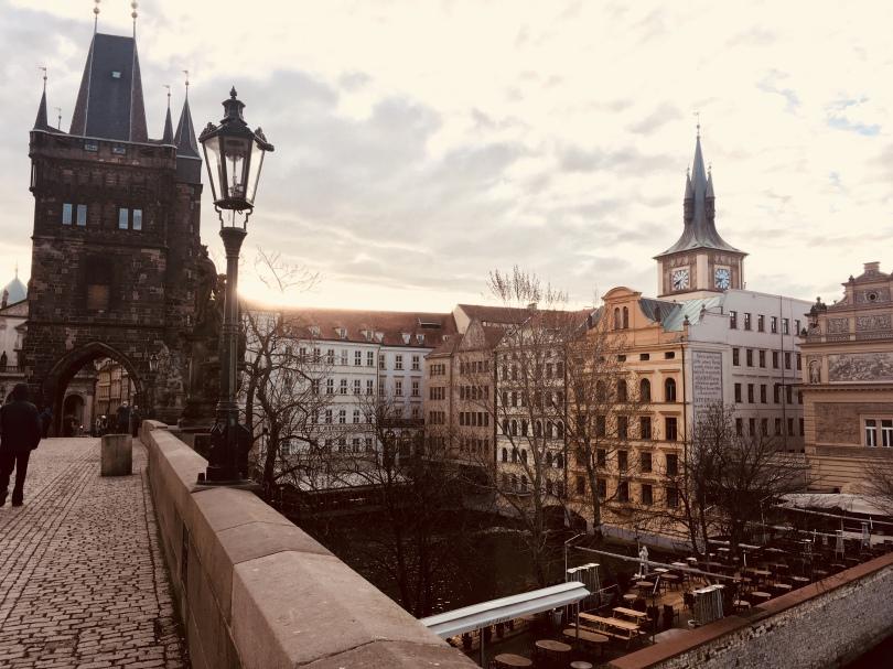 Early morning lighting of Charles Bridge towards Old Town in Prague, Czech Republic