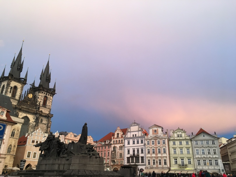 Old Town Square Prague, Czech Republic with Church of Our Lady before Týn and Jan Hus memorial with pastel coloured sunset