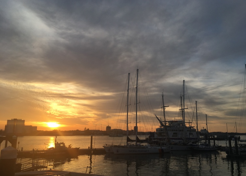 view of Portsmouth Harbour and boats at sunset in Portsmouth, UK
